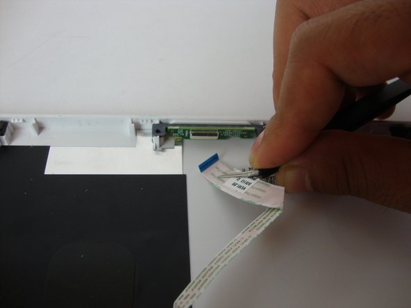 Use the tweezers to gently remove the white pogo board ribbon from the hinge connector.