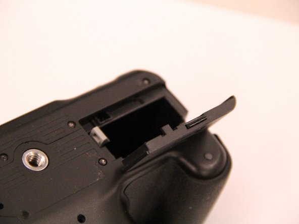 On the bottom of the camera, open the battery door and remove the battery.