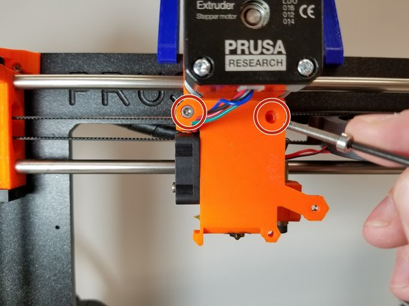 Remove the 2 X M3 Bolts from the Extruder Plate.