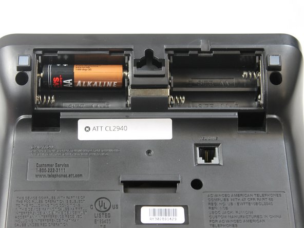 Place batteries in battery compartment with the positive end inserted at the side with the spring as shown.