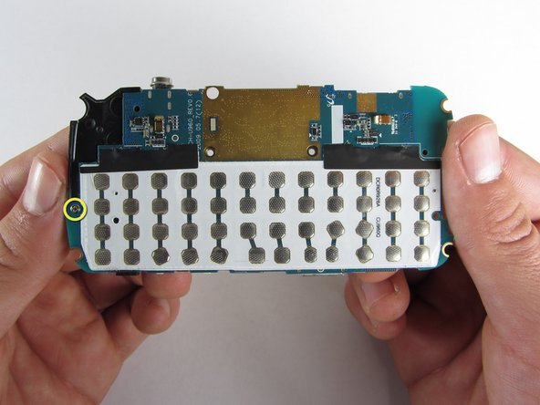 On the underside of the motherboard, remove the single 3.3mm Philips screw.