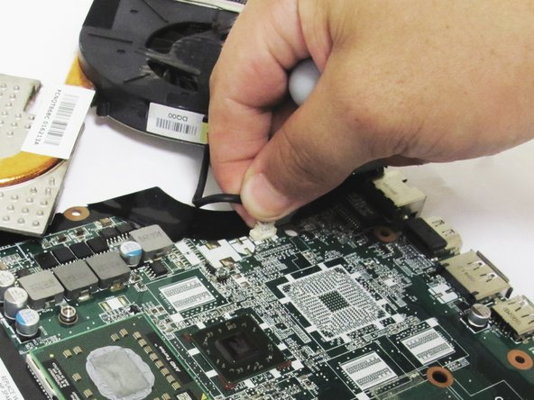 Unplug the fan power cable from the motherboard.