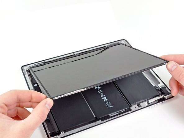 Image 1/1: Lift the LCD from its long edge closest to the volume buttons and gently flip it out of the rear case—like turning the page in a book.