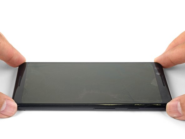 Lift up and remove the front glass from the phone.