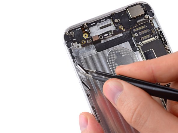 Gently grasp both top and bottom audio control buttons with a pair of tweezers and remove them from the iPhone.