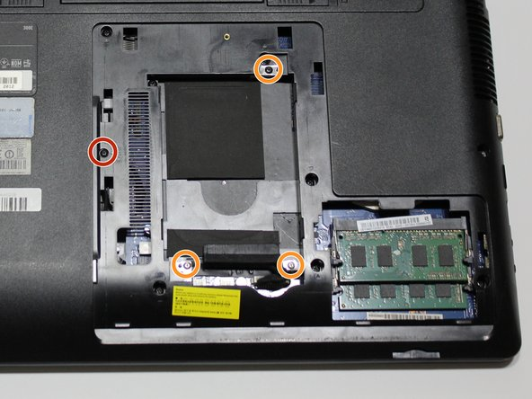 """Using the J0 Japanese Industrial Standard screwdriver, remove the 4.5mm screw next to the label """"ODD."""""""