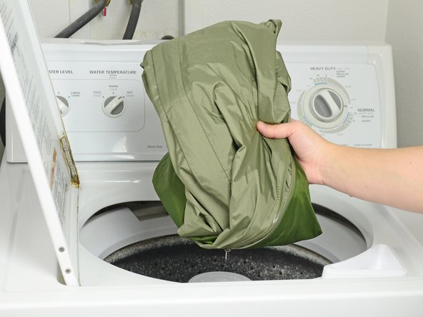 Place your jacket into the washer.