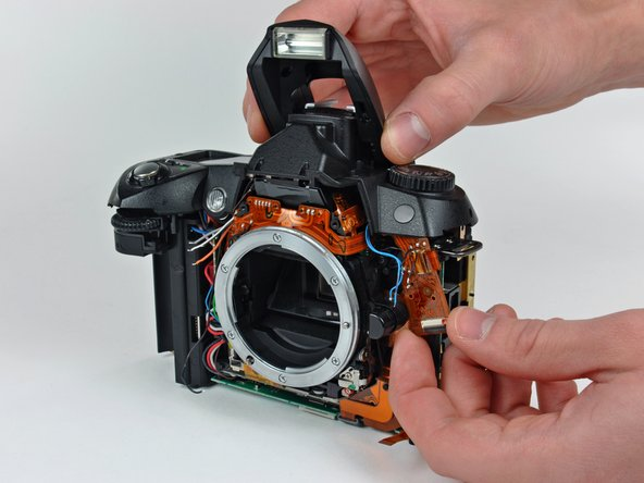 Image 1/2: Remove the top cover from the D70, minding any cables that may get caught.