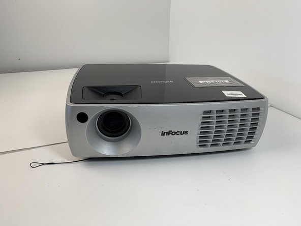 Turn the projector so that the lens is facing you.