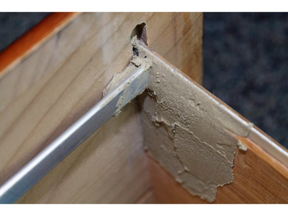 Reinforce the brace bar once you have properly placed it in the drawer front with wood putty to ensure stability.