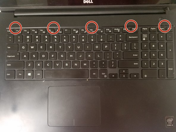 Locate the 5  holes at the top of the keyboard, as circled in Picture 2.