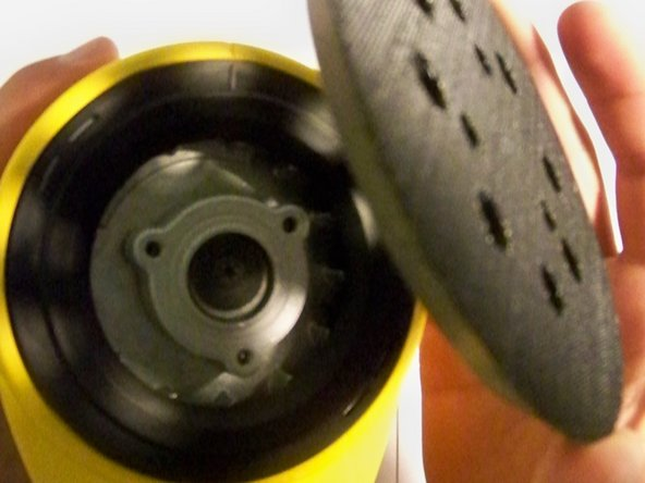 After the T20 torx bolts have been removed, remove the disc pad from the sander.