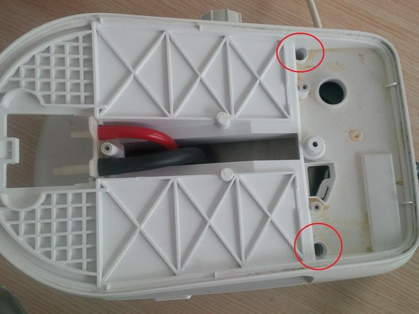 remove the torx screws inside the plastic holes, you'll need a longer torx screwdriver.