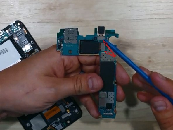 Pry up the connectors on the motherboard to release the front facing and rear facing camera if necessary.