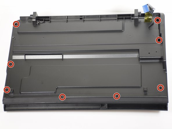 Remove eight T10 1mm screws from the top hood of the printer.