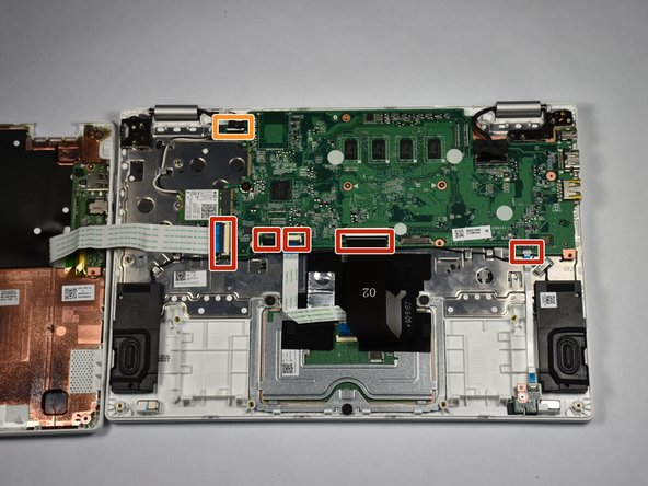 Using tweezers, pull the five ribbon cables near the bottom of the motherboard  from their sockets.