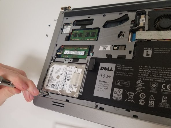Using the tab, lift the Hard Drive out of the laptop. (picture 3)