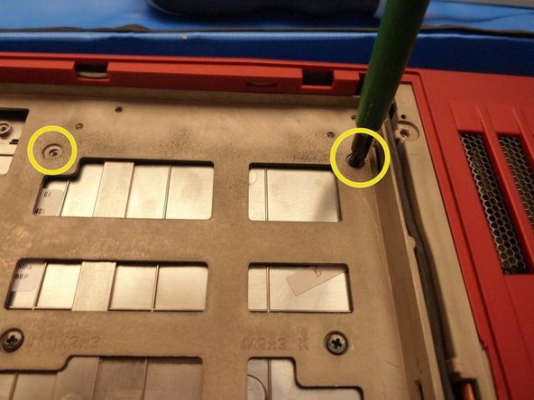 Image 3/3: Keyboard screws are marked with red circle.