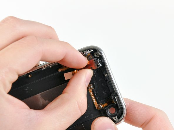 Image 2/2: Carefully pull the headphone jack away from the top edge of the rear panel.