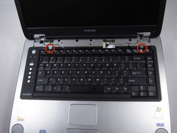 Remove two 3.67 mm screws from the keyboard.