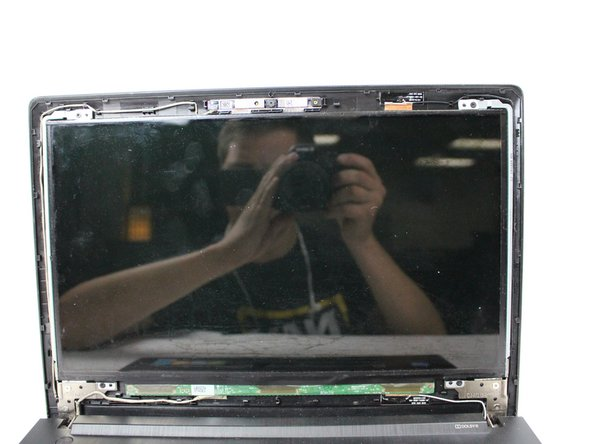 Carefully unsnap the front plastic piece to expose the frame of the screen.