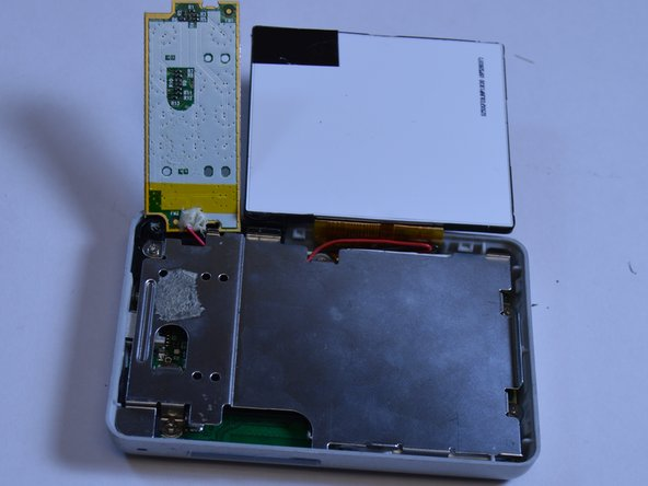 Lift open the LCD screen and button input chip to access the entire midsection plate.