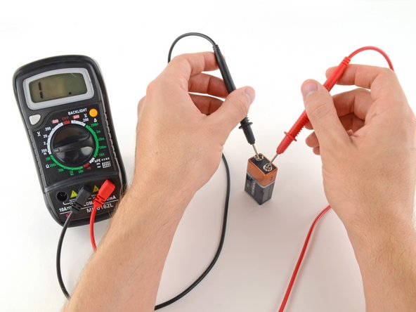 If your range was set too high, you may not get a very accurate reading. Here the multimeter reads 9 volts. That's fine, but we can turn the dial to a lower range to get a better reading.