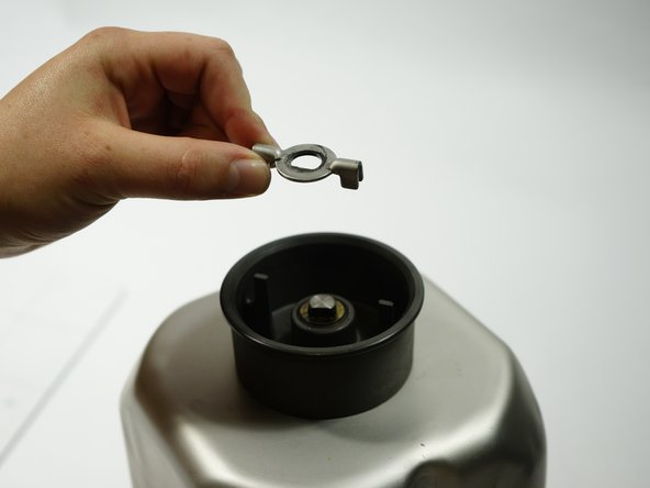 Once the clip is removed, the wing washer and circular washer can be easily removed by hand or tweezer.