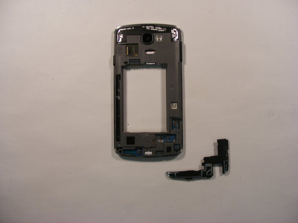 On the back side of the phone, loosen the bottom shield using the plastic opening tool, and remove it from the device.
