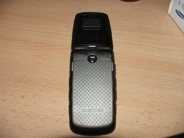 On the back side of the phone there is a cover over the battery and sim card compartment.