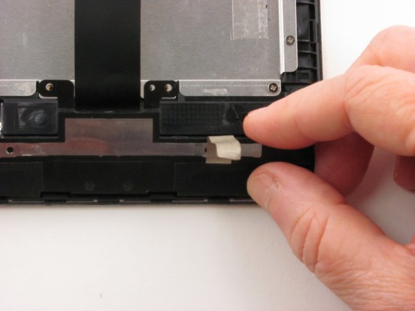 Remove the speaker assembly from the device.