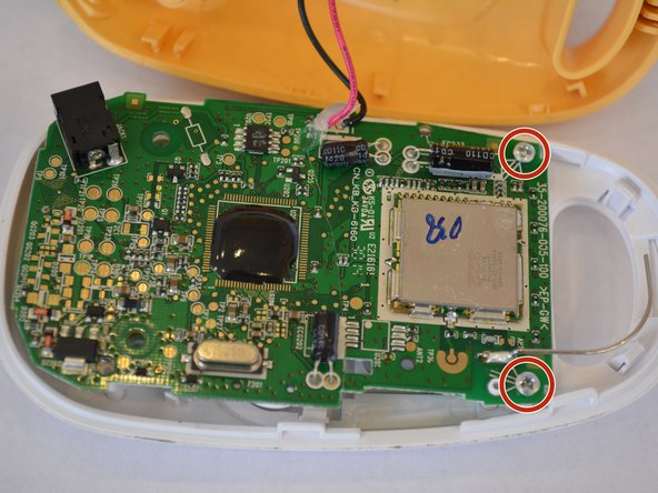 Image 1/2: Be careful removing the motherboard because there will be a set of wires connecting the speaker and motherboard.