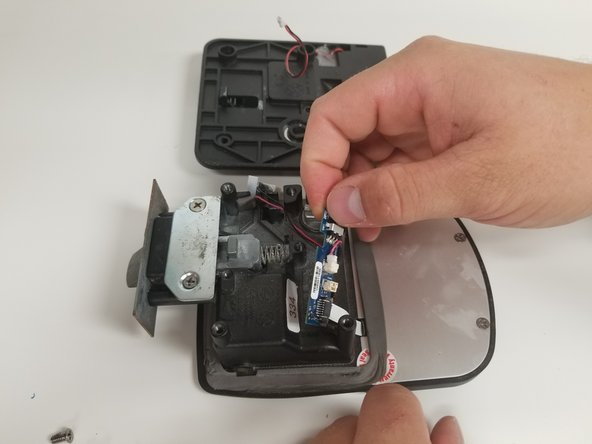 Pull the circuit board off the Bauer NE Electronic Trailer Lock housing, making sure not to pull it too far way from the housing.