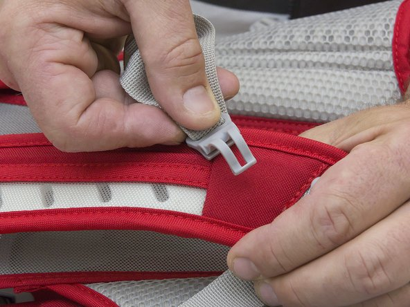 Guide the sternum strap onto the rail at the thin end.