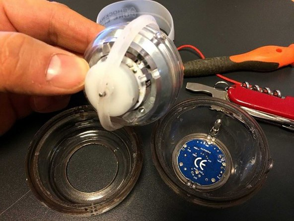 Remove gyro. It's connected to white plastic roundel which really is a part of inner bearing. It slides on the both sides of housing.