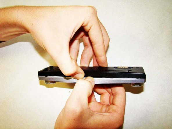 Use two fingers to create a small gap on the top of the faceplate, as indicated in the picture.