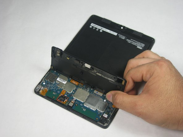 Remove the upper cover from the device.