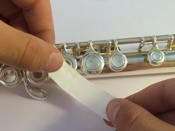 In the case that you are missing a felt pad entirely (just a bare cup), you can still fix your flute temporarily.
