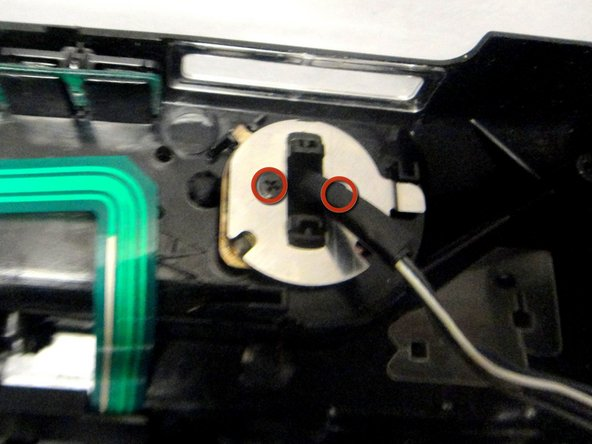 Remove (2) screws from viewfinder mount and electrical connecter, gently remove viewfinder unit from side cover.