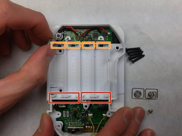 Image 2/3: Pull the remaining metal terminals out of their slots. Position them such that when removing the internal cover they will not be caught.