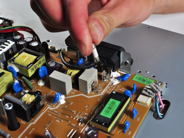Carefully remove the power supply fuse by hand.
