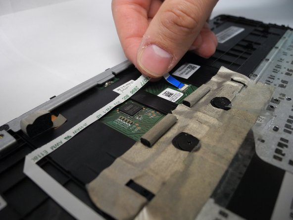 Image 2/2: The smaller ribbon cable requires nothing more than pulling it out gently.