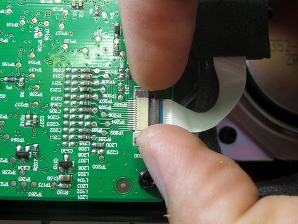 Image 2/3: Detach the band connector gently from the motherboard.