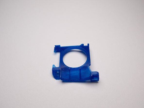 This part is separate and small so that you can print in a high temp resistant filament.
