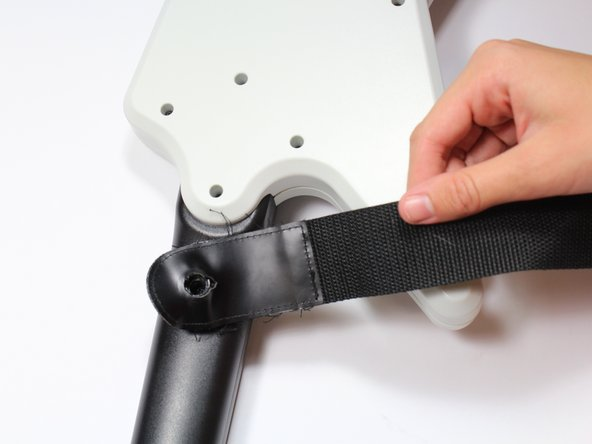 Remove the strap by pulling it off of the mounts located on the body and neck.