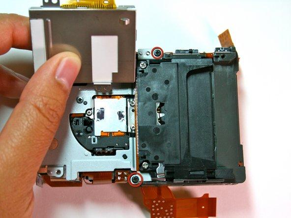 Remove the 2 black screws that attach the battery box to the housing plate.