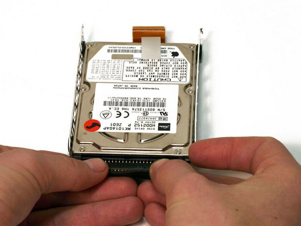 Applying even pressure during this step is key. You must be careful not to damage the hard-drive beyond repair.