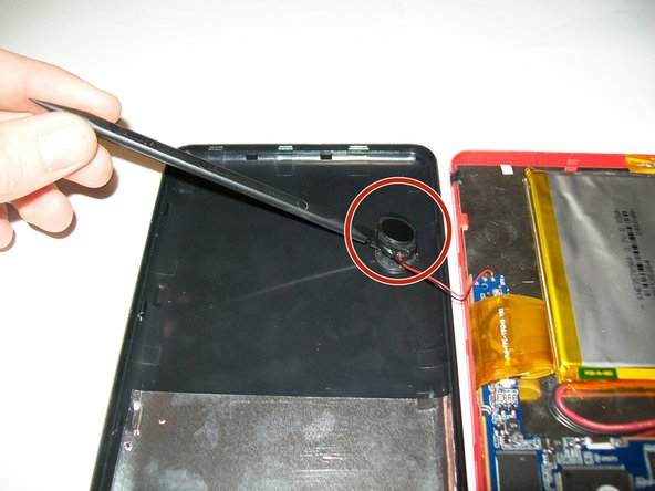 Use Spudger to remove speaker from back casing of the device.