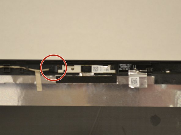 Now that the camera is exposed, disconnect the wire by hand to untether the camera unit from the motherboard.