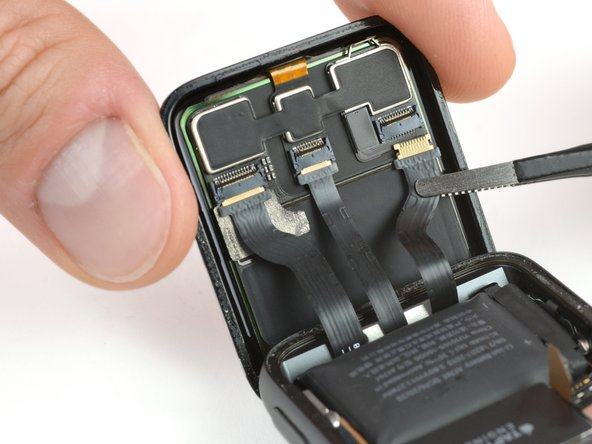 Use a pair of tweezers to disconnect the display flex cables by gently pulling them out.
